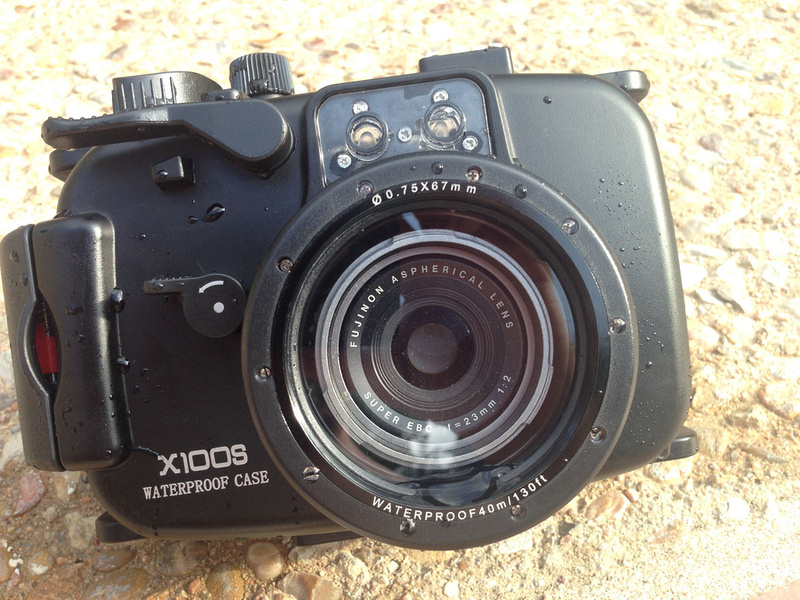Meikon underwater housing for x100s, open with camera inside.