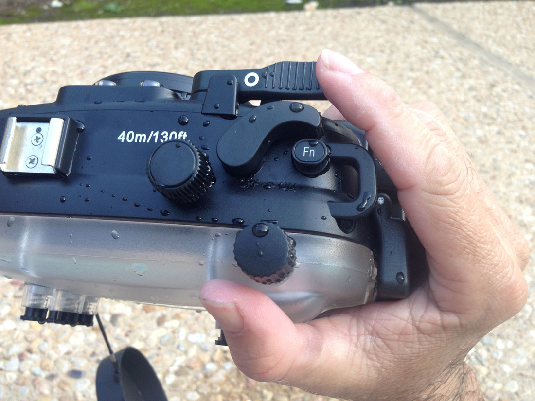 Meikon underwater housing for x100s, held in the hand